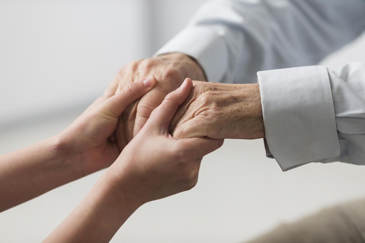 Nurse holding hands